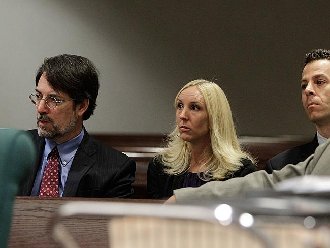 In court ... Nicole Oulson, second from left, listens with her attorneys Stephen Leal, le