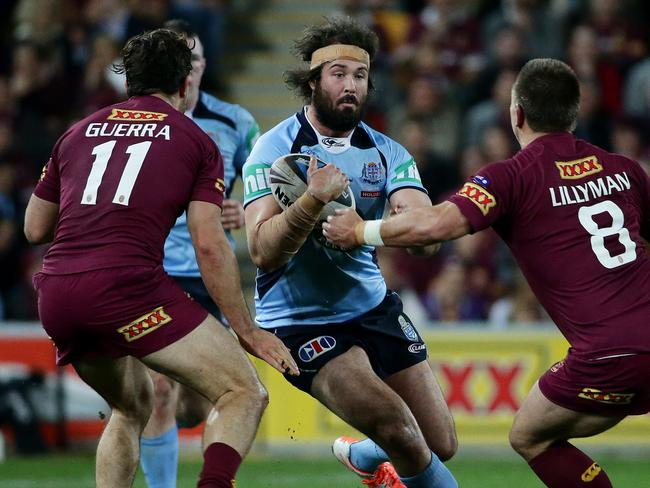 NSW forward Aaron Woods charges forward.