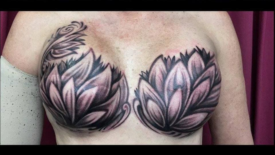 Darwin Tattoo Artist Covered Woman's Chest After Double