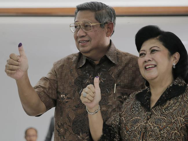 Outgoing Indonesian President Susilo Bambang Yudhoyono and First Lady Ani Yudhoyono display their inked fingers after voting in the Indonesian election yesterday. Picture: AFP Photo/presidensby.info/Abror Rizki