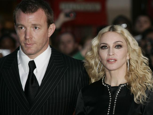 Happier times ... British director Guy Ritchie, left, and his ex-wife Madonna had two children together.