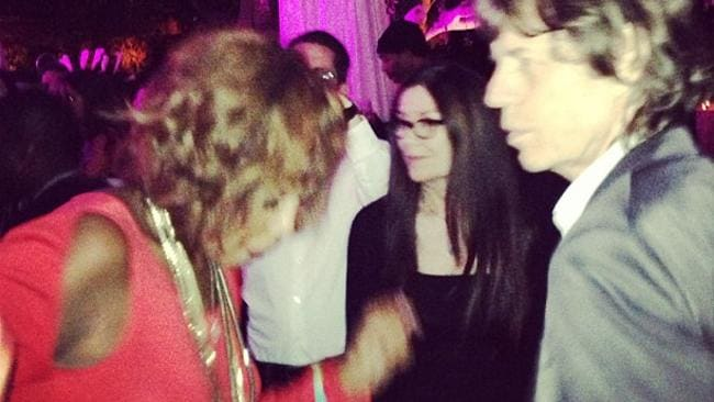 Gayle busts a move on the d-floor in front of Mick Jagger. Photo: Supplied/Instagram