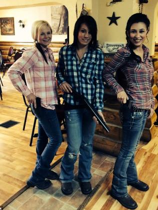 Armed and ready to take your order ... Waitress Ashlee Saenz (centre) carries a thigh-length Rueger Blackhawk .357 six-shooter.
