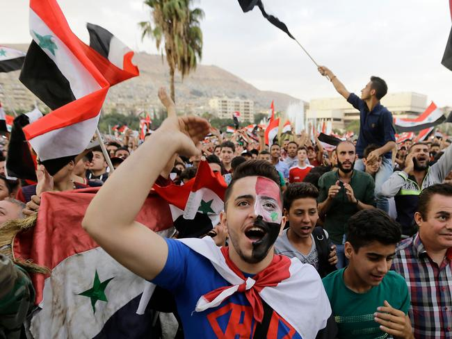 Syrians react as they watch a live broadcast of the first leg of Australia v Syria.