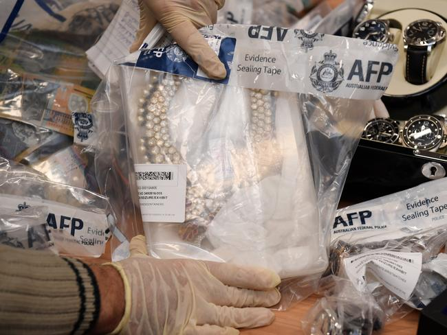 Seized items are displayed at a press conference at the AFP headquarters in Sydney on Thursday. Picture: AAP