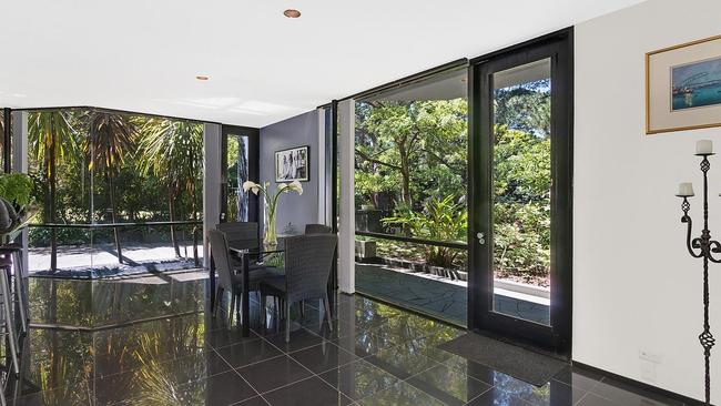 Large windows bring the lush gardens indoors.