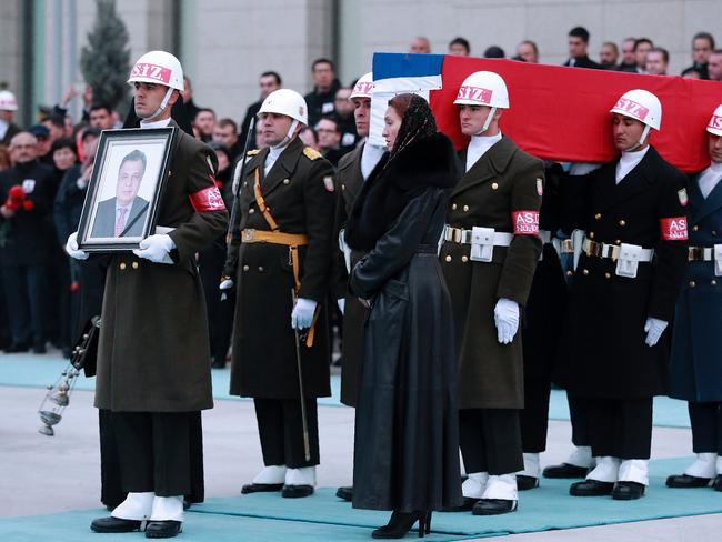 Members of a Turkish forces honour guard carry the Russian flag-draped coffin of late Russian ambassador to Turkey Andrey Karlov. Picture: AFP/Adem Altan