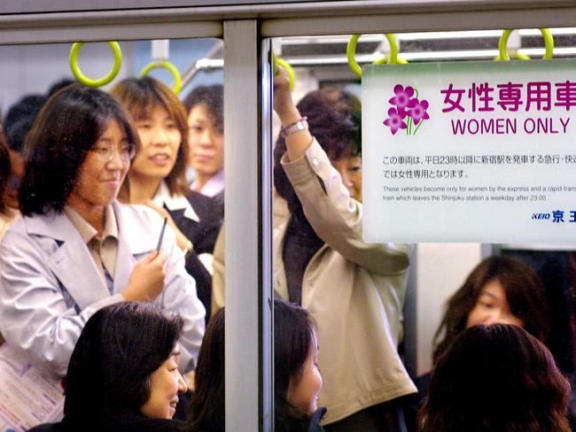 "Female commuters wait to leave Tokyo's Shinjuku station in Keio private railway's ""Women Only"" carriage."