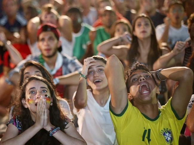 Fans watch a match on Copacabana Beach.