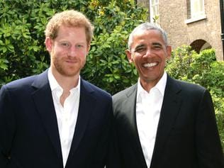 "A handout out photo released by Kensington Palace shows Britain's Prince Harry (L) posing for a photograph with former US President US, Barack Obama following a meeting at Kensington Palace in London on May 27, 2017. / AFP PHOTO / KENSINGTON PALACE / HO / RESTRICTED TO EDITORIAL USE - MANDATORY CREDIT ""AFP PHOTO / KENSINGTON PALACE"" - NO MARKETING NO ADVERTISING CAMPAIGNS - DISTRIBUTED AS A SERVICE TO CLIENTS"