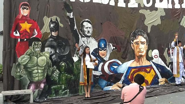 A student seen posing in front of the offending mural. Picture: Chulalongkorn University