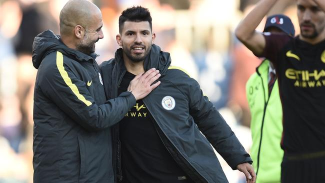 Manchester City's Spanish manager Pep Guardiola has a test against table toppers Chelsea.