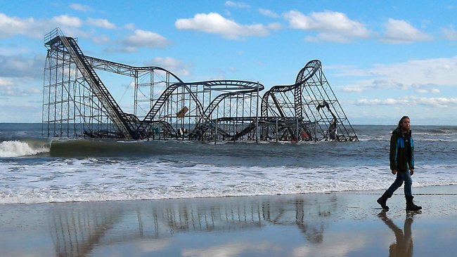 Jersey Shore smashed: a rollercoaster that once sat on the Funtown Pier in Seaside Heights, N.J., rests in the ocean after the pier was washed away by superstorm Sandy. (AP Photo/Julio Cortez)