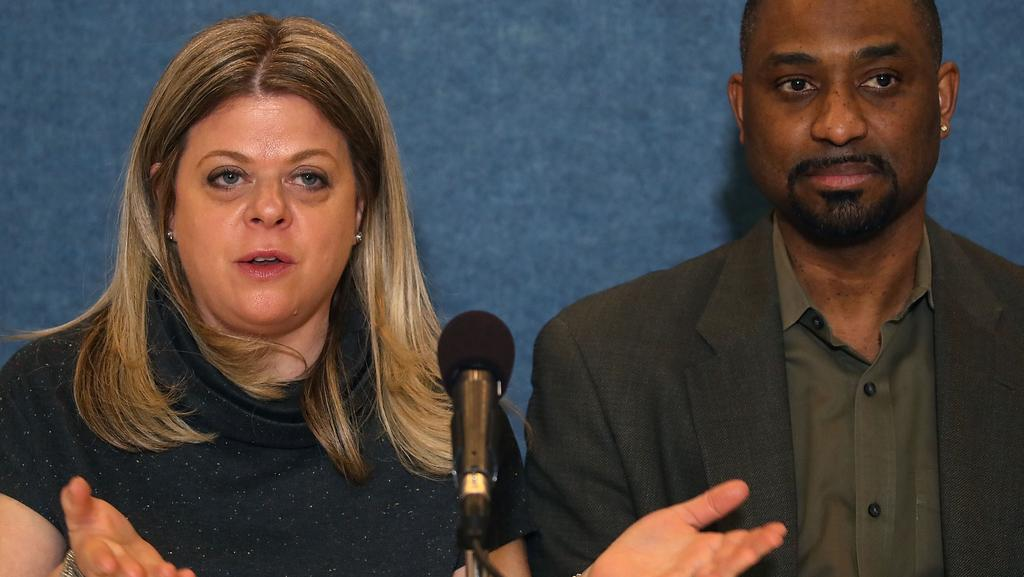 Husband and wife restaurateurs Khalid Pitts and Diane Gross speak during a news conference about their unfair competition lawsuit against President Donald Trump. Picture: Mark Wilson/Getty Images/AFP