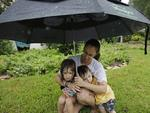 Laura Linton holds her children Lea, 4, and Josh, 3, after evacuating a neighborhood inundated by floodwaters from Tropical Storm Harvey on Monday, Aug. 28, 2017, in Houston, Texas. Picture: AP Photo/Charlie Riedel
