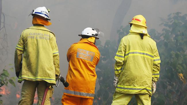 Firefighters in Cairns monitor a bushfire at East Trinity. File picture