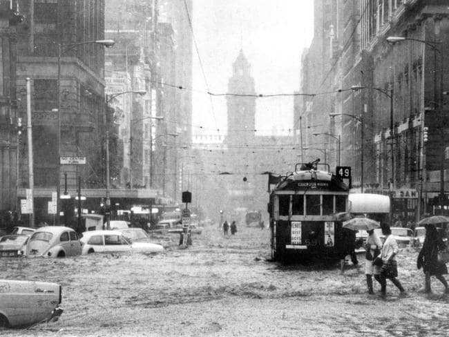 1972: Record rainfall turns Elizabeth St into a river. Picture: Herald Sun Image Library
