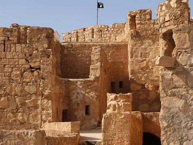 Invasion ... the Islamic State militants flag flies above Palmyra castle in the Syrian town of Palmyra, Syria. Picture: the website of Islamic State militants via AP