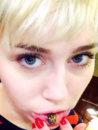 We've lost track of how many tatts Miley has.