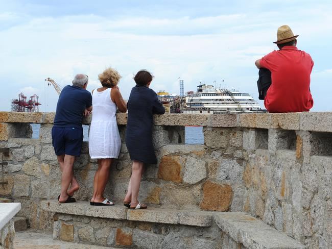 Tourist spot ... people watch the Costa Concordia refloating operations on July 14. Picture: Getty
