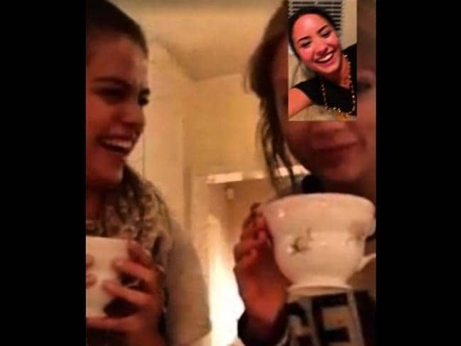 Happier times ... Selena Gomez and Taylor Swift find it hard to keep a straight face while Facetiming with Demi Lovato