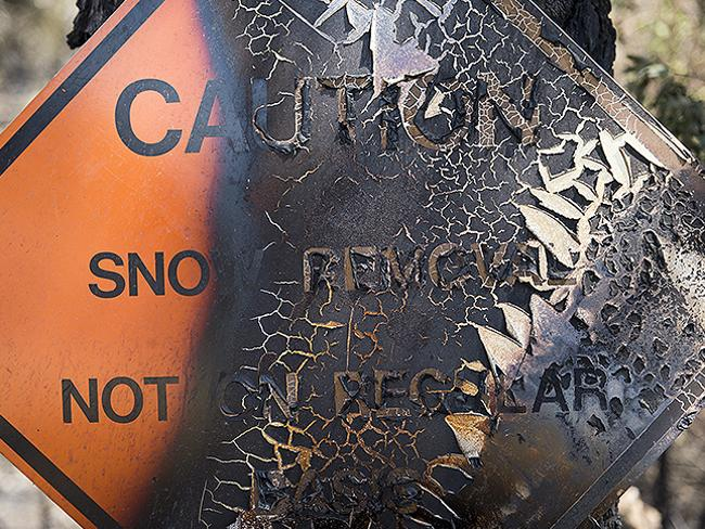 Paint peels after the sign was burned from the Rim Fire in the Stanislaus National Forest along Highway 120 near Yosemite National Park. Picture: AP