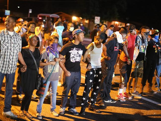 United front ... Demonstrators protest the shooting death of teenager Michael Brown. Picture: AFP