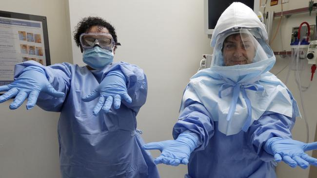 US health workers ... trained in the use of protective suits they'll need to treat suspected Ebola cases. Picture: AP