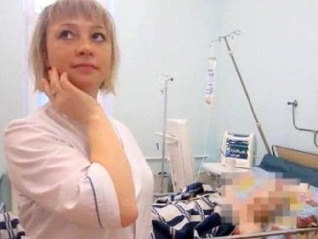 Tatiana Katayeva poses with another intensive care patient. Picture: East2West News