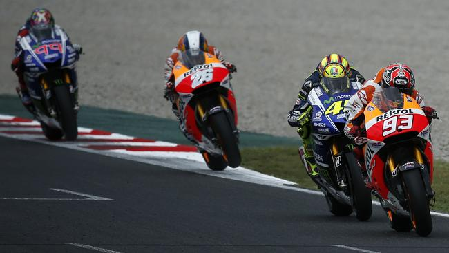 Marquez battles Rossi and Pedrosa, with Lorenzo trailing.