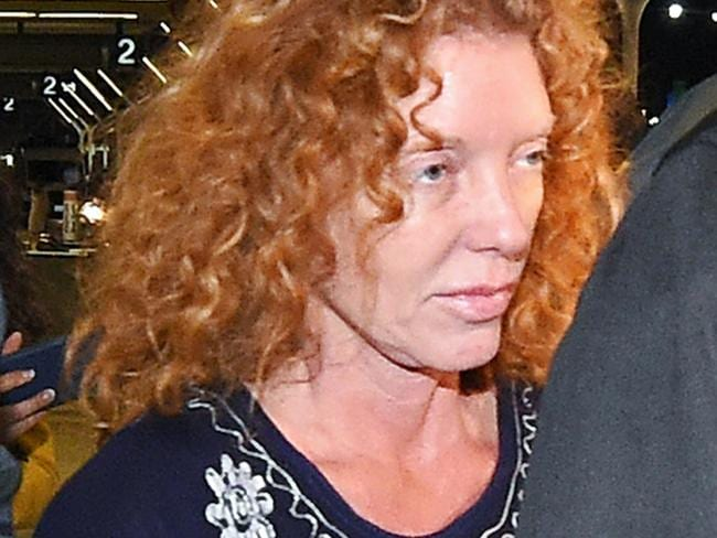 Arrested ... Tonya Couch is taken by authorities to a waiting car after arriving at Los Angeles International Airport. Picture: AP
