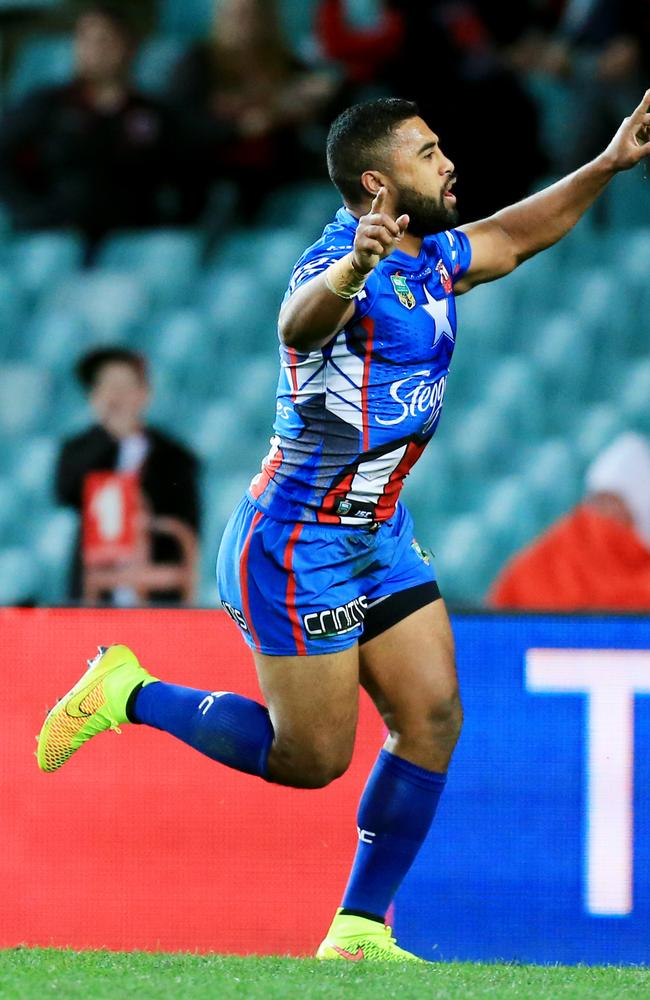 Michael Jennings Roosters celebrates a try.