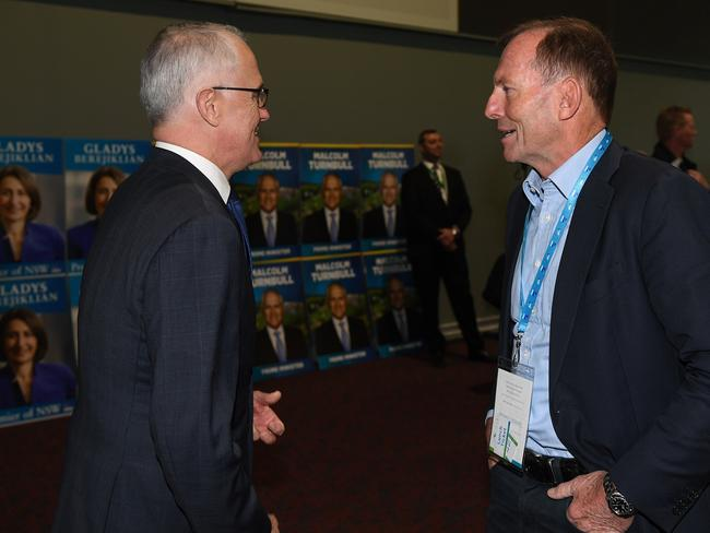 Prime Minister Malcolm Turnbull and former prime minister Tony Abbott speak during the NSW Liberal Party Futures convention. Picture: AAP