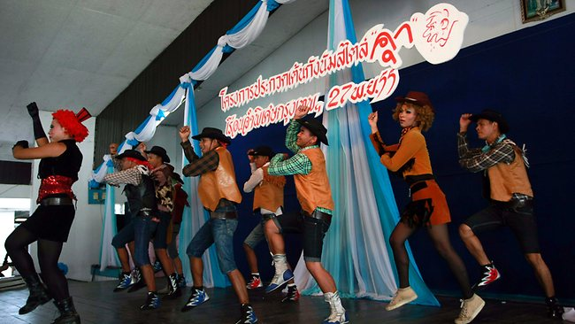 Thai inmates perform PSY's Gangnam Style moves during a dancing competition. Picture:AP /Apichart Weerawong