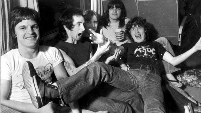 ACDC on their tour bus in 1976: Mark Evans (left), Bon Scott, Phil Rudd, Malcolm Young and Angus Young. Picture: Gary Graham