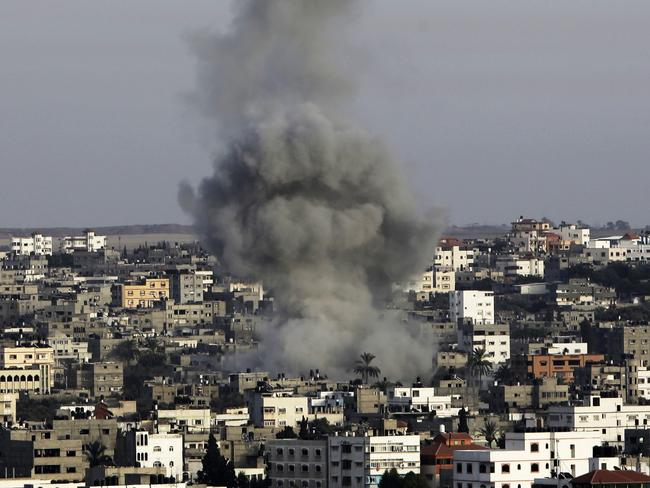 Rockets fly ... Smoke rises following an Israeli strike on the Gaza strip overnight.