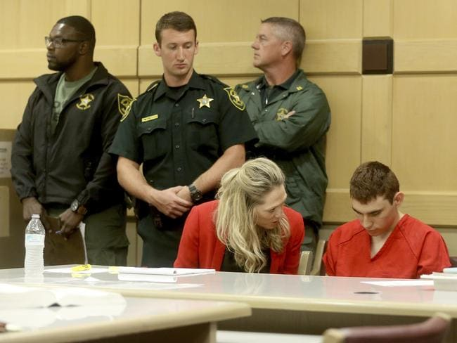 The 19-year-old spoke briefly to his defence team. Picture: Mike Stocker/South Florida Sun-Sentinel via AP