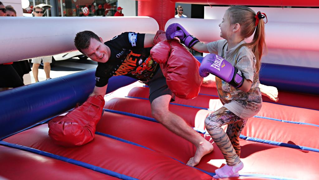 Six-year-old Shanae Holden from Karalee gives Jeff Horn the old one-two in Mt Gravatt. Picture: Annette Dew