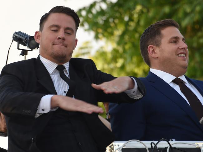 Channing Tatum dances as he and actor Jonah Hill arrive at the Regency Village Theatre in LA.