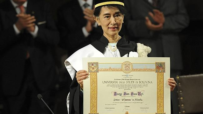 Aung San Suu Kyi, Myanmar's Nobel Peace Prize laureate and former long-time political prisoner poses with her honorary university degree in Philosophy from the University of Bologna, Italy. (AP Photo/Gianni Schicchi)