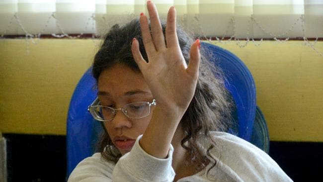 Broke down in tears during questioning ... daughter Heather Mack. Picture: AFP/ Sonny Tumbelaka