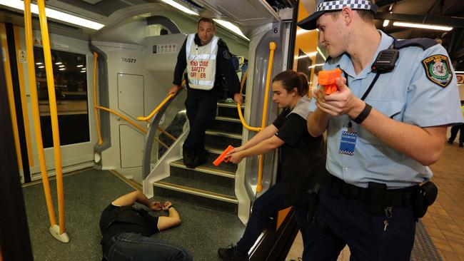 Police officers arrest a 'terrorist' on train. Picture: Supplied