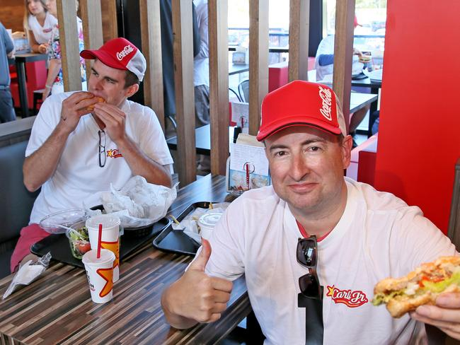 Second in line Peter Wilding says the Carl's Jr burger is the Rolls Royce, and McDonald's is the Toyota Corolla. Picture: Troy Snook