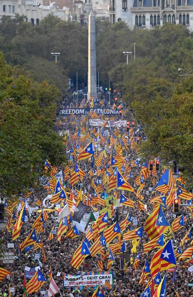 Protesters wave pro-independence Catalan Estelada flags during a demonstration in Barcelona. Picture: AFP