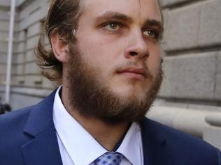 South African murder accused Henri van Breda arrives at the high court in the city of Cape Town, South Africa, Friday, Sept. 9, 2016. Van Breda, who faces three counts of murder for the ax killings of his parents and older brother, appeared in the Cape Town high court with his case being postponed to Nov. 18, 2016. (AP Photo/Schalk van Zuydam)