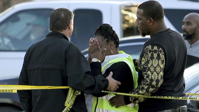 Jefferson Parish Sheriff Newell Normand consoles a woman at the scene.