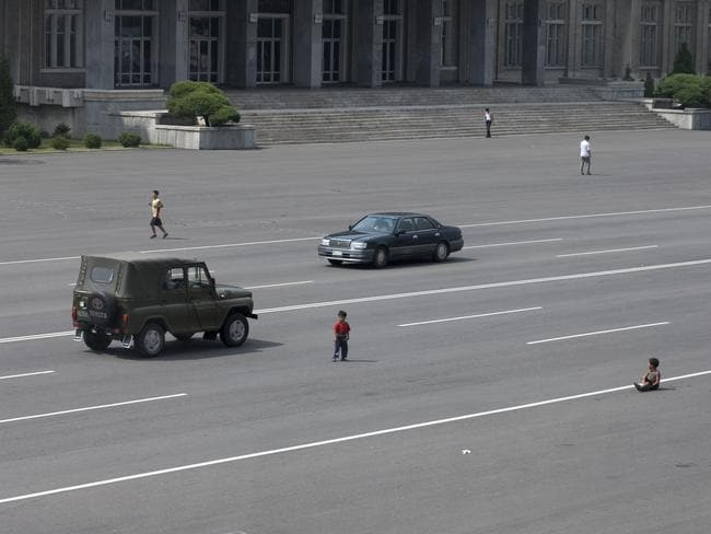 'As cars have become more widespread in Pyongyang, the peasants are still getting accustomed to seeing them. Kids play in the middle of the main avenues just like before when there were no cars in sight.'