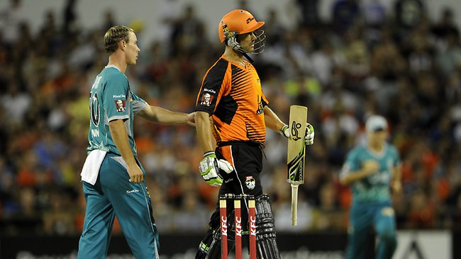Brisbane's Chris Lynn gives Perth's Nathan Coulter-Nile a pat on the back as he leaves the field, out for 16. Picture: Daniel Wilkins