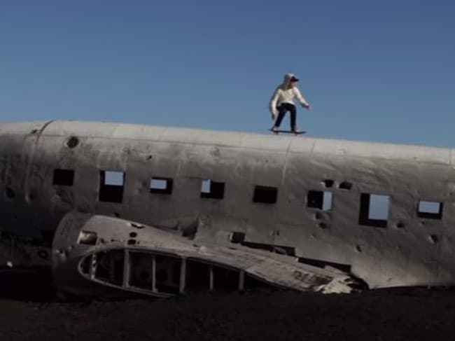 Screenshot of Justin Bieber skateboarding on top of the US plane wreck on Sólheimasandur in his music video for 'I'll Show you'.