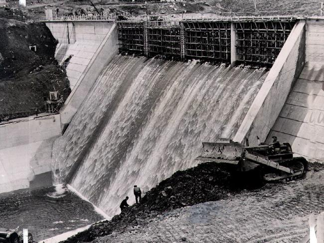 Water pouring over the spillway of Guthega Dam 5, a 100-foot mass concrete gravity dam that is part of Snowy Mountains scheme.